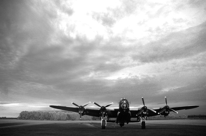 Lancaster bomber against sky