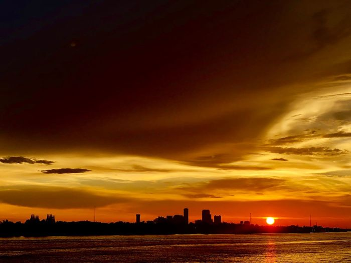 One day ends and a new one begins Skyline New Day Dawning Sky Sunset Cloud - Sky Architecture Orange Color Building Exterior A New Beginning Water No People Silhouette City Tranquility Outdoors My Best Photo