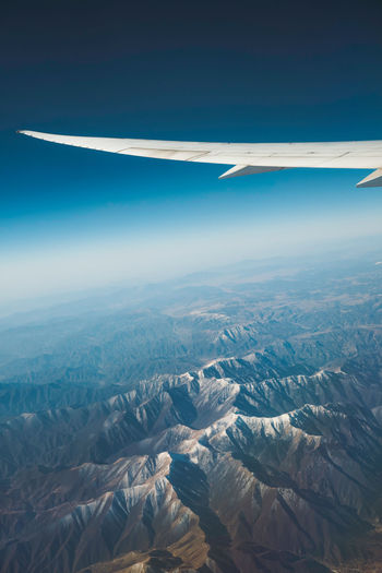 Blue sky, snow mountain, airplane, travel Landscape Outdoors Day Nature Airplane Transportation Flying Mode Of Transportation No People Travel Aircraft Wing Sky Aerial View Environment Beauty In Nature Scenics - Nature Mountain Motion on the move Mountain Range Snowcapped Mountain
