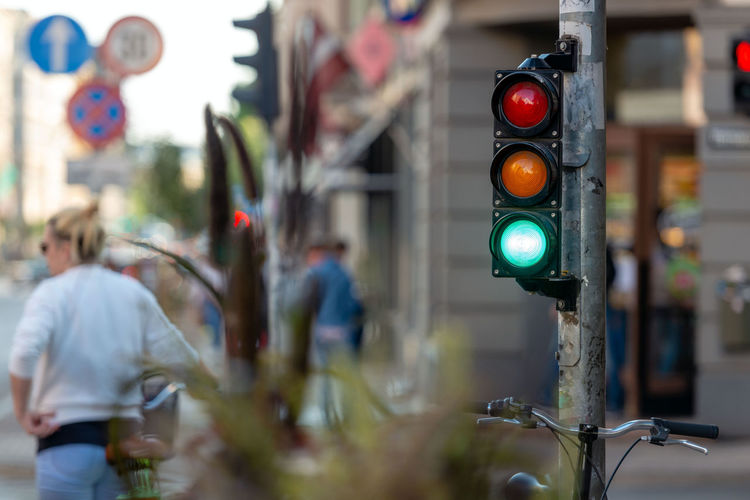 Abstracts of metropolitan streets with crossroads and traffic lights. Abstract Architecture Bicycle Building Exterior City City Life Communication Crossroads Day Green Light Guidance Illuminated Light Metropolis Metropolitan Outdoors Red Light Road Road Sign Road Signal Sign Stoplight Street Transportation
