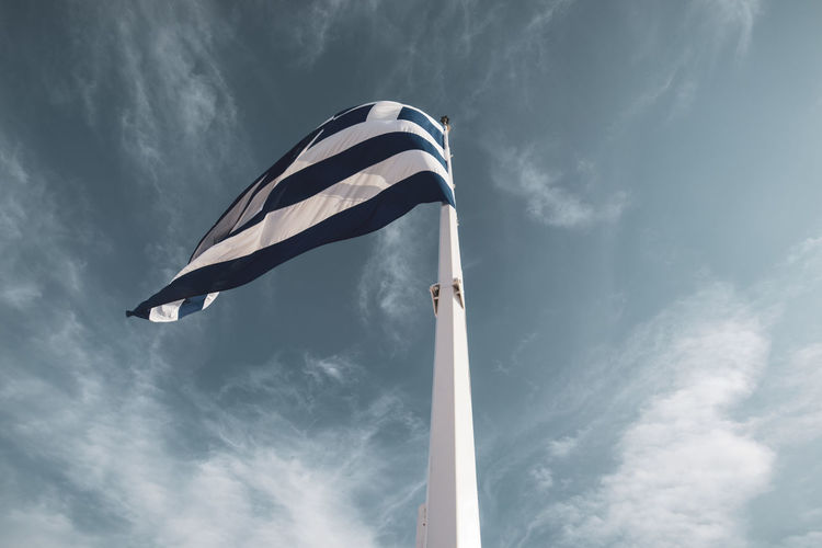 Acropolis Athens Greece Acropolis Cloud - Sky Sky Low Angle View Patriotism Flag Nature Day Environment Pole Wind No People Outdoors Waving Motion Emotion Striped Pride Blue Flying National Icon Independence