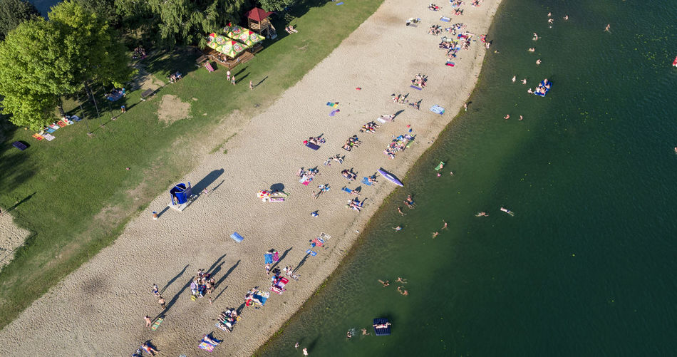 High angle view of people enjoying in water