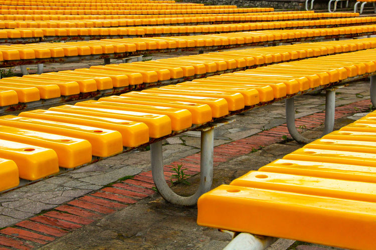 A Lot Of Benches City City Life Close-up Day In A Row Meetings Multitude No People Outdoors Same  Yellow