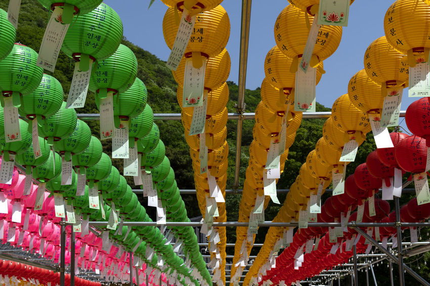view of Bomunsa, a famous Buddhism temple in Seokmodo, Kimpo, Gyeonggido, South Korea Bomunsa Buddhism Temple Seokmodo Abundance Belief Buddhism Choice Day Decoration Ganghwado Hanging Lantern Large Group Of Objects Lighting Equipment Low Angle View Multi Colored No People Outdoors Pattern Place Of Worship Religion Repetition Side By Side Temple