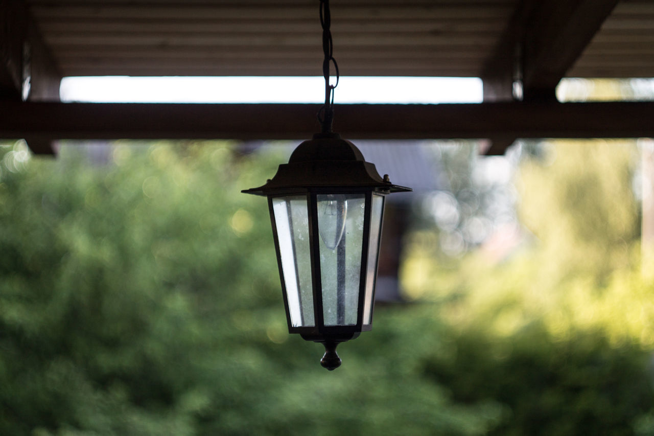 hanging, lighting equipment, focus on foreground, no people, day, light bulb, indoors, lantern, illuminated, architecture, close-up