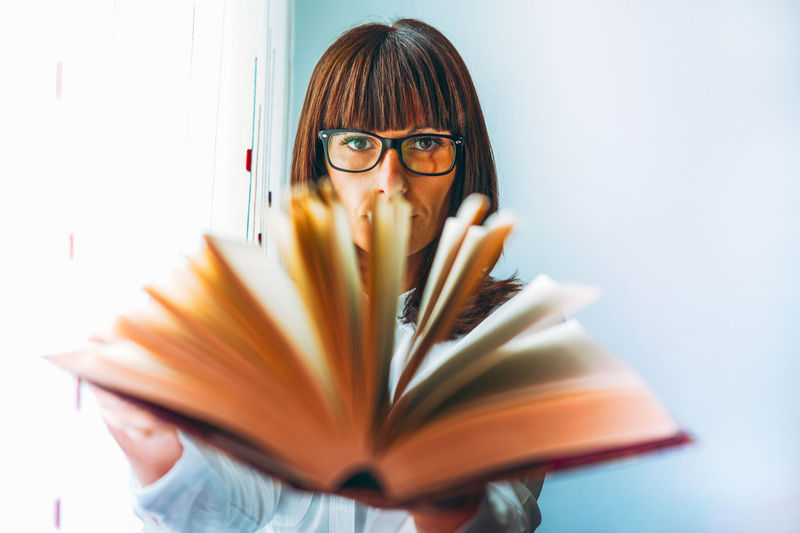 Portrait of woman holding book