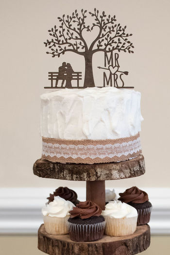 Rustic-Style Wedding Cake and Cupcakes Cakes Chocolate Dessert Reception Rustic Wedding Wood Baked Cake Dessert Food Food And Drink Indulgence Marriage  No People Sweet Sweet Food Temptation Vanilla Wedding Cake
