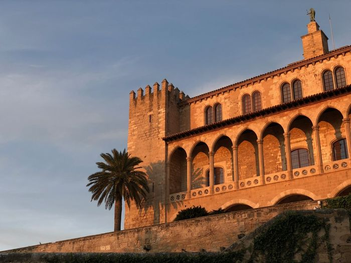Palma de Mallorca, Spain Historical Building Mediterranean  Orange Sunset Palm Tree Palma De Mallorca Red Sun SPAIN Architecture Building Building Exterior Built Structure Day Evening Sun Low Angle View No People Outdoors Sunset Sunset Buildings Travel Destinations