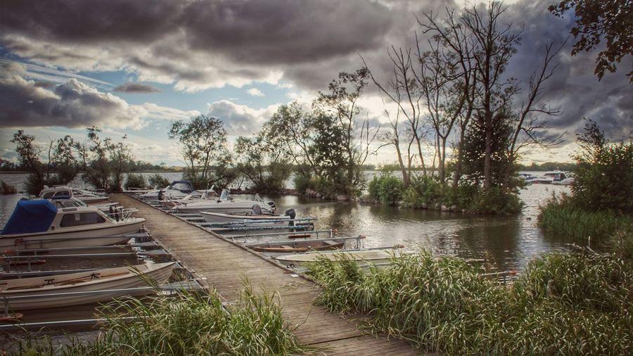 #boats #boat #clouds #water #footbridge #port #sweden #sverige #nature #trees Tree Water Flood Sky Cloud - Sky