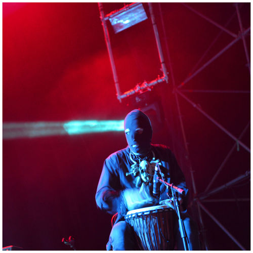 Musician Playing Djembe During Concert At Night