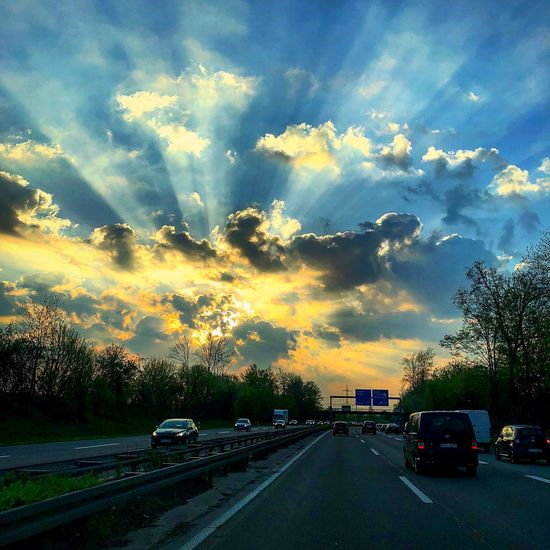 Roadtrip Car Cloud - Sky Motor Vehicle Sky Mode Of Transportation Transportation Land Vehicle Road No People City Nature The Way Forward Street Tree Sunset Direction Plant Motion Architecture Beauty In Nature