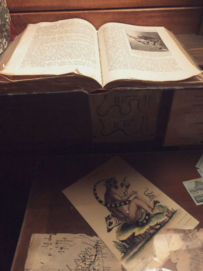 High angle view of open book on table at home