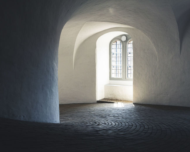 Copenhagen, Denmark København Roundtower Arch Arched Architecture Building Built Structure Copenhagen Day Direction Empty Flooring History Indoors  Nature No People Old Rundetaarn Sunlight The Past The Way Forward Wall Wall - Building Feature Window