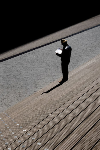 Amsterdam Lonely The Week on EyeEm Tourist Architecture Day Footpath Full Length High Angle View Leisure Activity Lifestyles Man In Hat Map Reading Men Nature One Person Outdoors Real People Rear View Shadow Standing Street Photography Sunlight Water Wood - Material #FREIHEITBERLIN The Street Photographer - 2018 EyeEm Awards