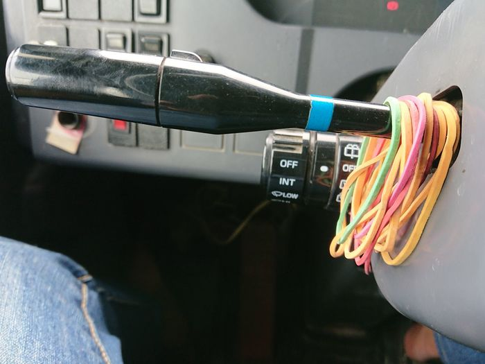 Close-Up Of Rubber Bands On Toggle Switch
