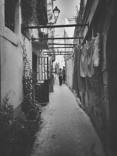 People in alley of residential district
