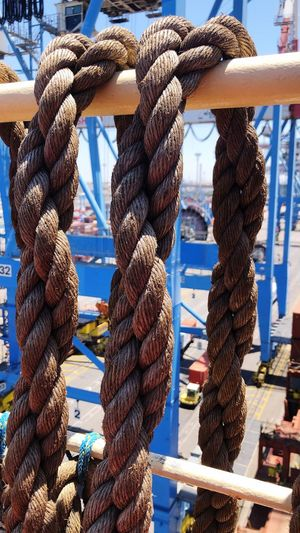 Close-up of ropes tied up in a harbor