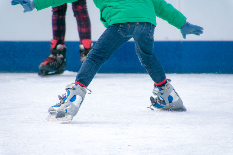 Activity Balance Boys Child Childhood Cold Temperature Day Enjoyment Fun Ice Ice Rink Ice Skate Ice-skating Leisure Activity Lifestyles Low Section Motion Playing Real People Skateboard Skating Skill  Sport Winter Winter Sport Fashion Stories Shades Of Winter