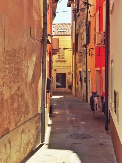Izola old town Sea Town City EyeEm Eyeem Market EyeEm Best Shots Izola Building Exterior Built Structure Architecture Direction Building The Way Forward City Sunlight Transportation Day Real People Shadow Residential District Street Wall - Building Feature Communication Footpath Nature Incidental People