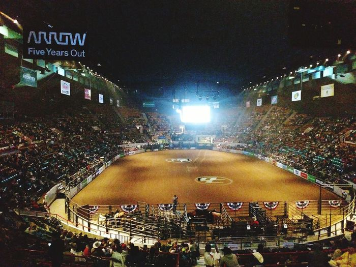 National Western Stock Show Cowboys Stage Coach Wagons Old West Rodeo Western Lifestyle Colorado Tradition Night Illuminated Crowd Arts Culture And Entertainment Architecture Building Exterior Stage - Performance Space Stadium People Fan - Enthusiast