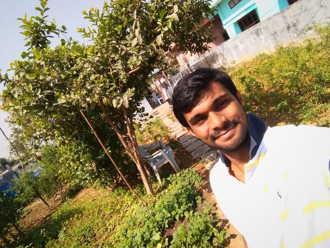 in my green home Beauty In Nature Greenery EyeEm Selects Environment Mid Adult Mid Adult Men Tree One Person Day Growth Casual Clothing Lifestyles Plant Real People Happiness One Man Only Front View Outdoors Smiling Headshot Only Men Young Adult Nature Men