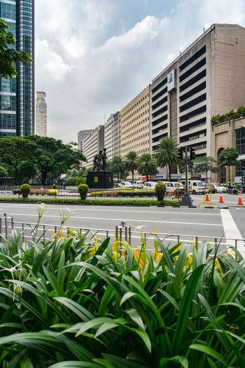 City street by buildings against sky