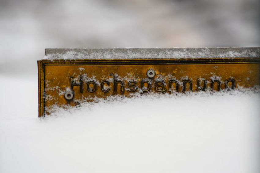 Winter in Berlin Berlin Close-up Cold Temperature Day Gelb Hochspannung  Metal Nature No People Outdoors Schild Schnee Sign Snow Snowing Spannung Weather Weiss Winter