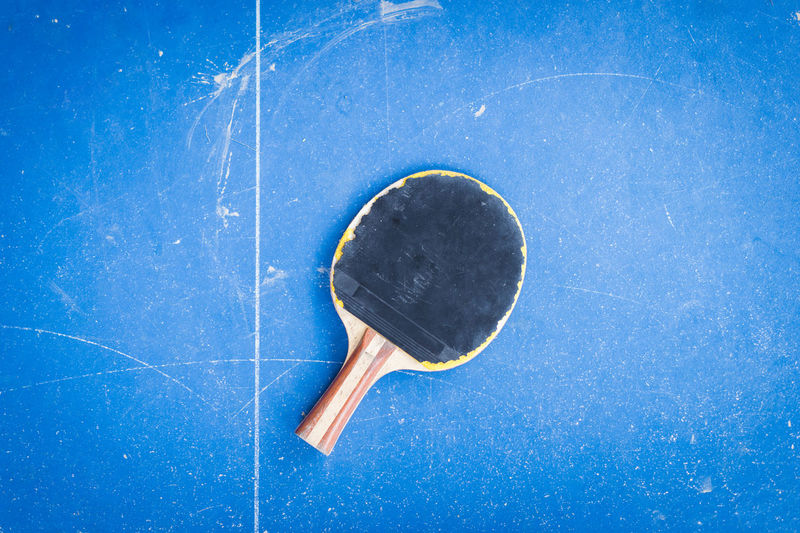Close up of tennis racket on table