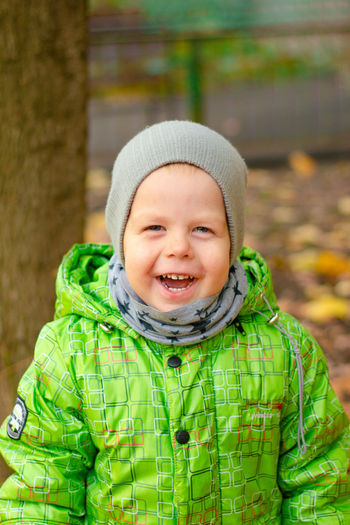 Portrait of cute boy in park during winter