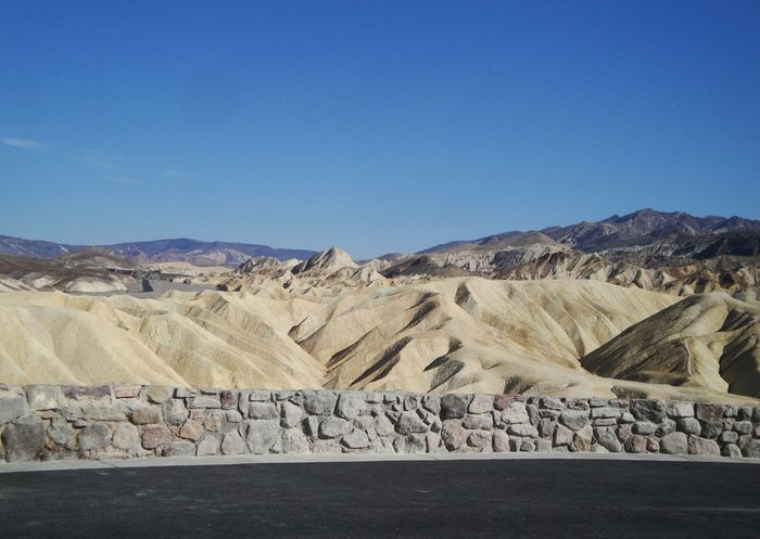 Nature Tranquility Geology Tranquil Scene Scenics Beauty In Nature Landscape Physical Geography Blue Desert Clear Sky Day Outdoors Arid Climate Mountain Non-urban Scene Extreme Terrain No People Zabriskie Point Death Valley Badwater Taking Photos Popular Photos Femalephotographerofthemonth 43GoldenMoments