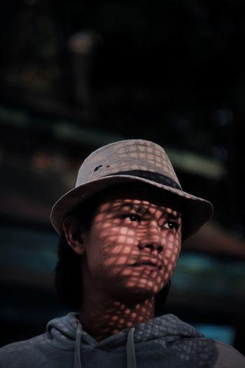 Rear view of man wearing hat