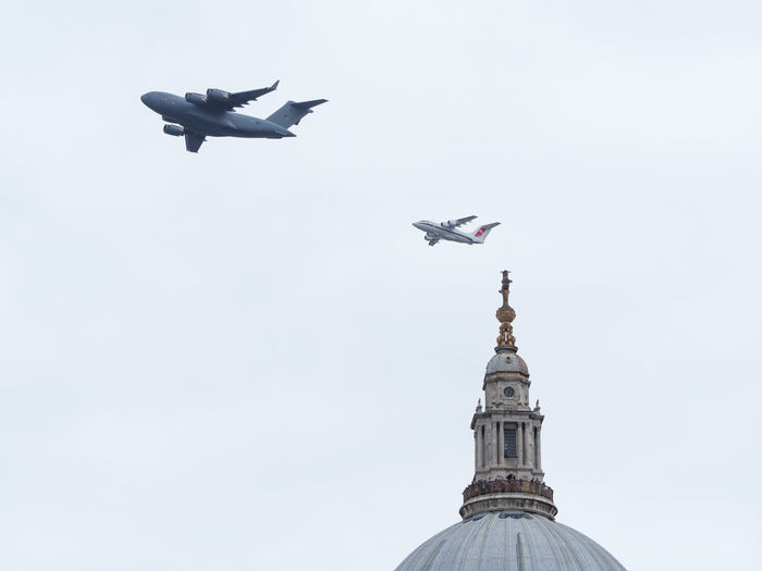 C-17 Globemaster and BAE146 Planes during the RAF 100 Years Flypast above St Paul's Cathedral in London C-17 C-17 Globemaste Globemaster RAF 100 Year Flypast St Paul's Cathedral Aerospace Industry Air Vehicle Airplane Architecture Bae146 Building Exterior Built Structure Day Dome Flight Flying Low Angle View Mid-air Mode Of Transportation No People Outdoors Plane Sky Transportation Travel Destinations The Photojournalist - 2018 EyeEm Awards