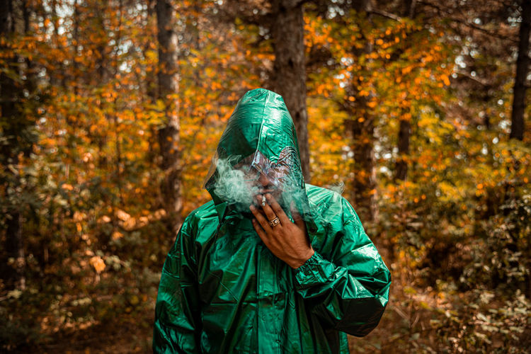 Man wearing mask in forest during autumn