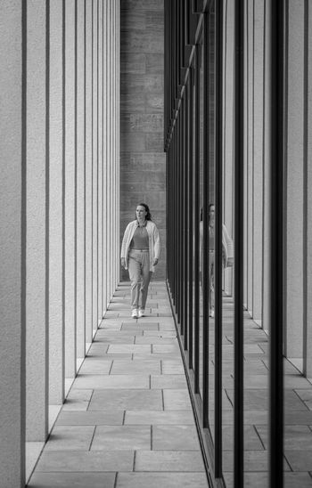 Full length of woman walking in corridor of building