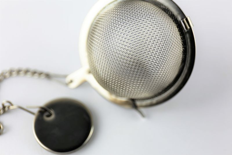 An Image of a tea strainer Coffee Tea Close-up Day Drink Drinking Eat Egg Indoors  Kitchen No People Strain Strainer Studio Shot Tea Time Technology