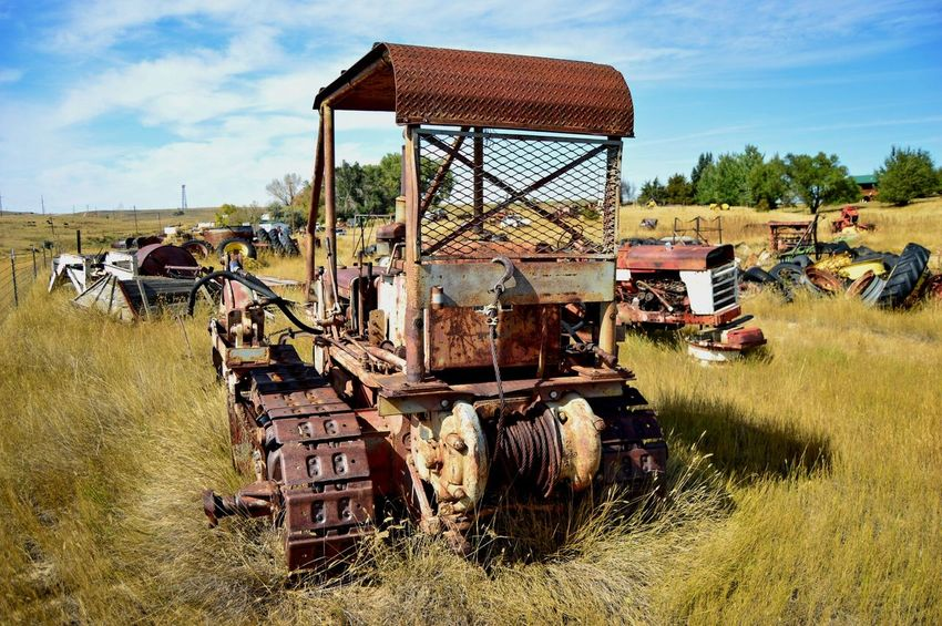 Machinery graveyard Clouds And Sky North Of Douglas Wyoming Sunshine Shadow Old Outdoors Run-down Deterioration Obsolete Bad Condition Abandoned Junkyard Broken Rusty Weathered