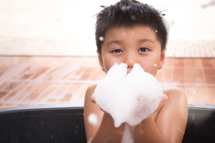 Close-up portrait of boy holding ice cream