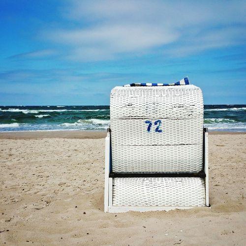Hooded beach chair on beach