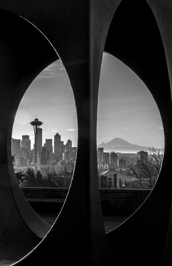 Space Needle Against Sky In City Seen Through Window