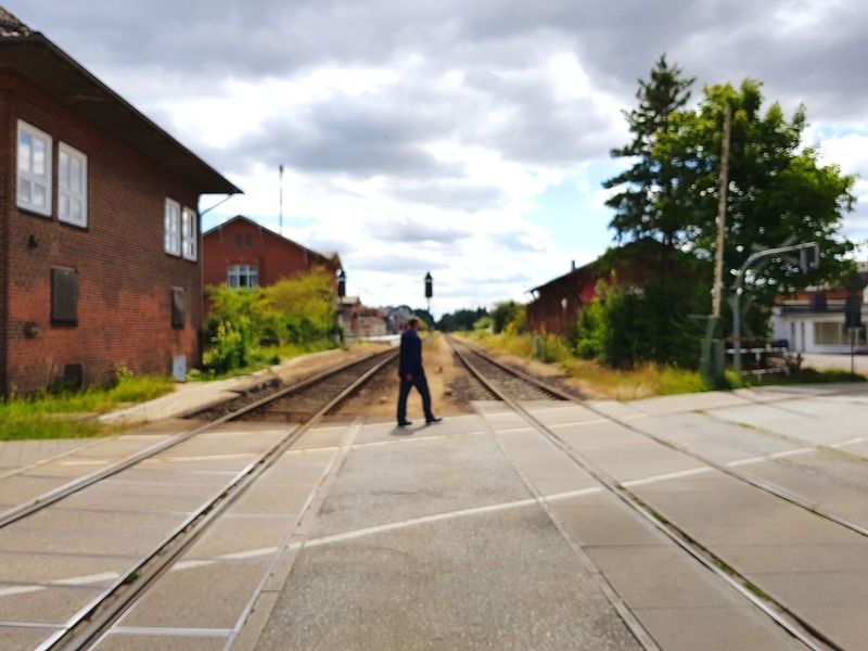 Mölln, Bahnhof One Man Only One Person Cloud - Sky Full Length Only Men Danger Adult Rear View Men People Sky Built Structure Outdoors Adults Only Standing Day Architecture Train Station Railway Railway Track Railway Station Taking Photos Taking Pictures Timepaint72