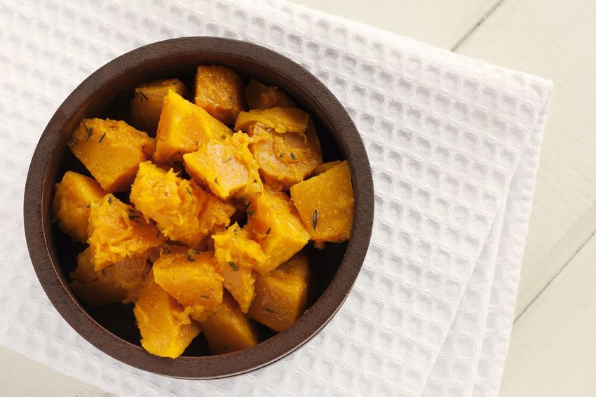Boiled pumpkin with thyme. Food And Drink Ready-to-eat Close-up Healthy Eating No People Vegetable Boiled Pumpkin Boiled Studio Photography Natural Light UnykaProductions Thyme Directly Above Pumpkin Diet Wooden Bowl White Napkin Kitchen Towel Wooden Background White Background