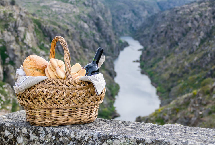 Picnic fun Basket Beauty In Nature Close-up Day Freshness Mountain Nature No People Outdoors Picnic Basket Rock - Object