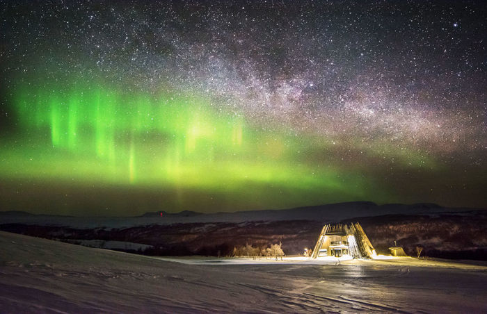 Astronomy Aurora Polaris Beauty In Nature Cold Temperature Constellation Galaxy Green Color Illuminated Landscape Mountain Nature Night No People Outdoors Road Scenics Sky Space Star - Space Water