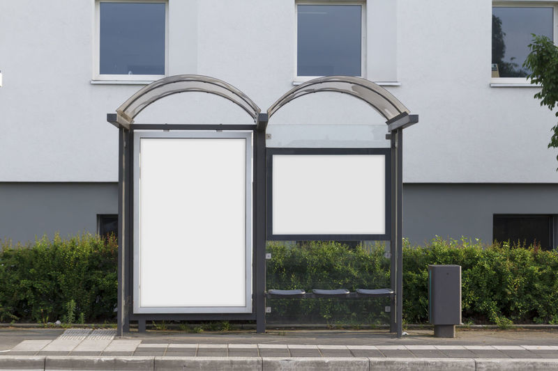 Blank billboard in a bus stop Advertisement Posters Advertising Billboards Branding Advertisement Architecture Billboard Blank Building Building Exterior Bus Stop City Copy Space Day Empty Marketing Mock Up Nature No People Outdoors Plant Street White Color Window
