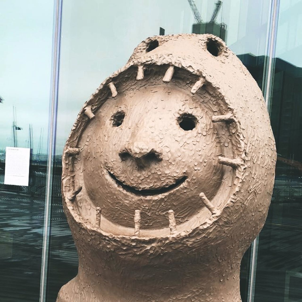 close-up, representation, no people, art and craft, architecture, day, human representation, sculpture, craft, creativity, indoors, built structure, focus on foreground, building, anthropomorphic, arts culture and entertainment, anthropomorphic face, face, statue