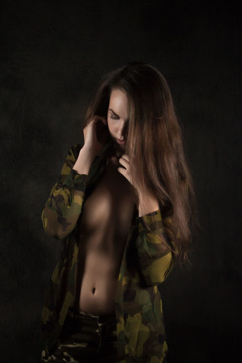 Adult Beautiful Woman Beauty Black Background Brown Hair Contemplation Emotion Hair Hairstyle Indoors  Long Hair Looking One Person Semi-dress Standing Studio Shot Three Quarter Length Women Young Adult Young Women