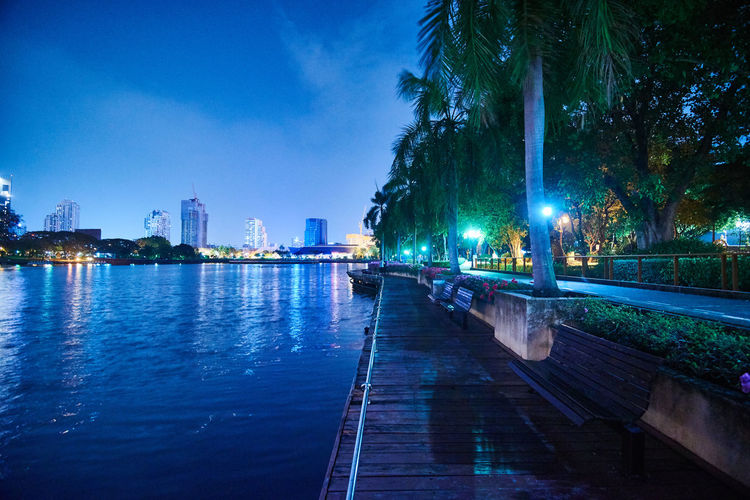 Water Architecture Built Structure Tree Building Exterior Illuminated Sky Plant Nature City Night No People Waterfront Building Transportation River Outdoors Reflection Dusk Office Building Exterior Skyscraper Long Exposure Park