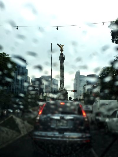 Rainy days Picoftheday Architecture Travel Built Structure Travel Destinations Sky Car City Land Vehicle Transportation AngelDeLaIndependencia Pictureoftheday Mexico City Column Monument City Life City Mobility In Mega Cities