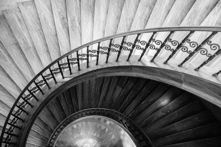 The spiral stairs in black and white Architecture Built Structure Steps And Staircases Staircase Spiral Staircase Railing Indoors  Spiral No People High Angle View Pattern Building Day Directly Above Repetition Design Diminishing Perspective Absence Ceiling