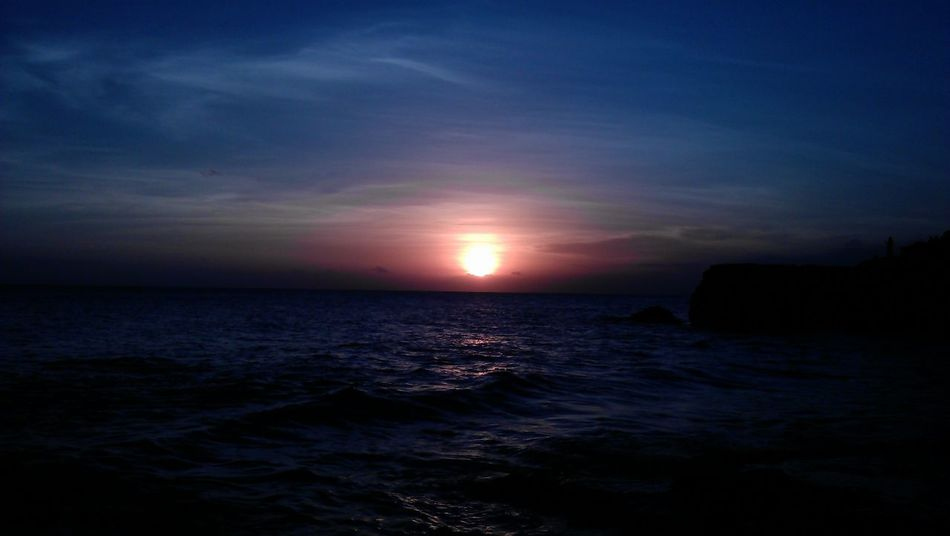 Astronomy Beauty In Nature Day Horizon Over Water Idyllic Nature No People Outdoors Scenics Sea Silhouette Sky Sun Sunset Tranquil Scene Tranquility Water Waterfront Wave